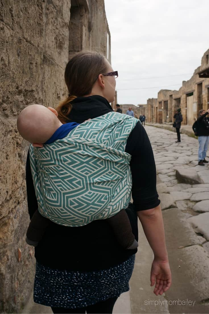 woman wearing baby in a woven wings double hammock in Pompeii Italy