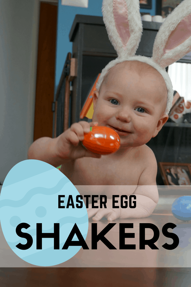 Little boy holding easter egg shaker craft