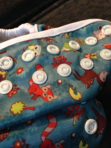 alternating snaps along the front of the diaper.