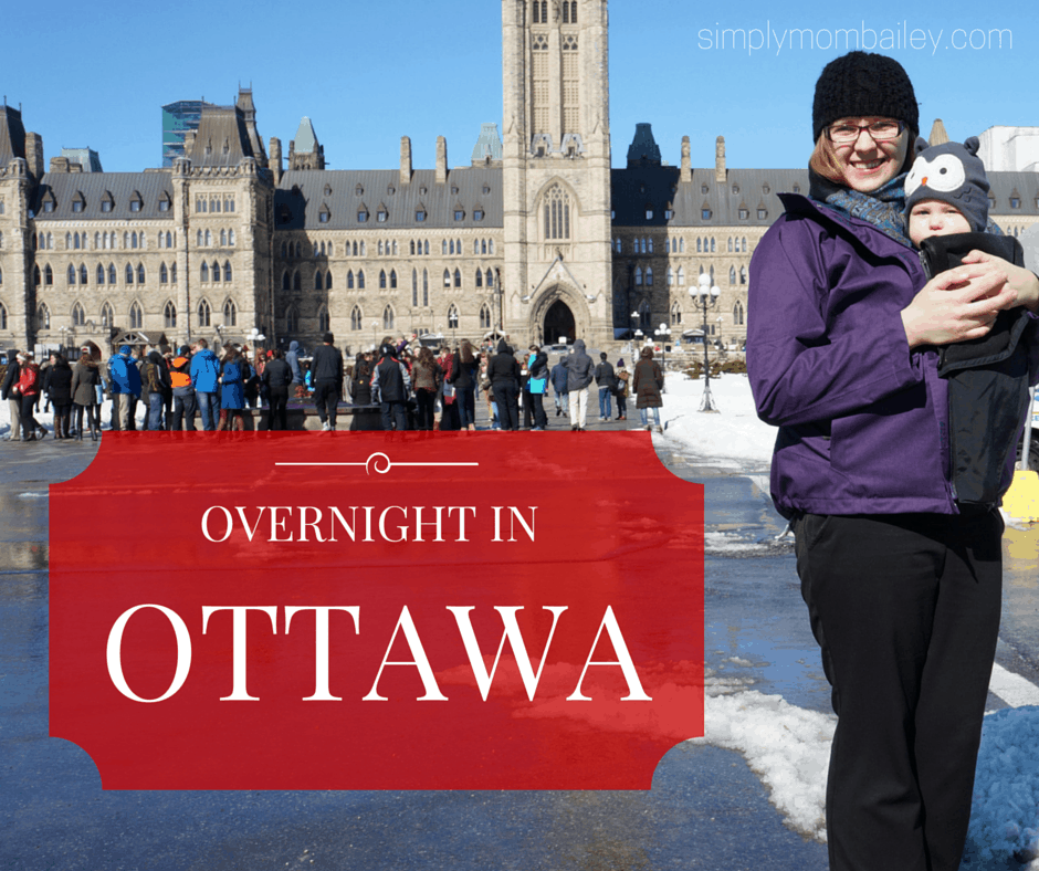 mom and baby at Canadian Parliament Buildings in Ottawa in Winter