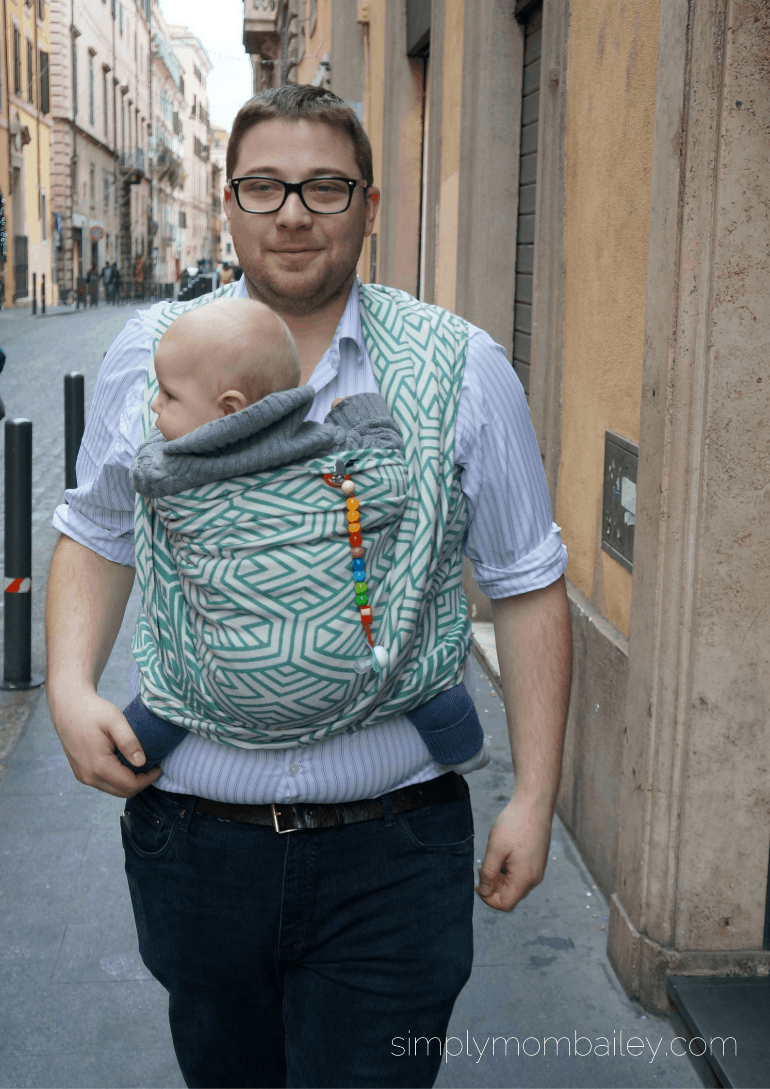 dad wearing baby in woven wrap in the streets of rome, italy