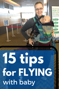 15 tips for flying with a baby, a mom wearing her baby in the airport