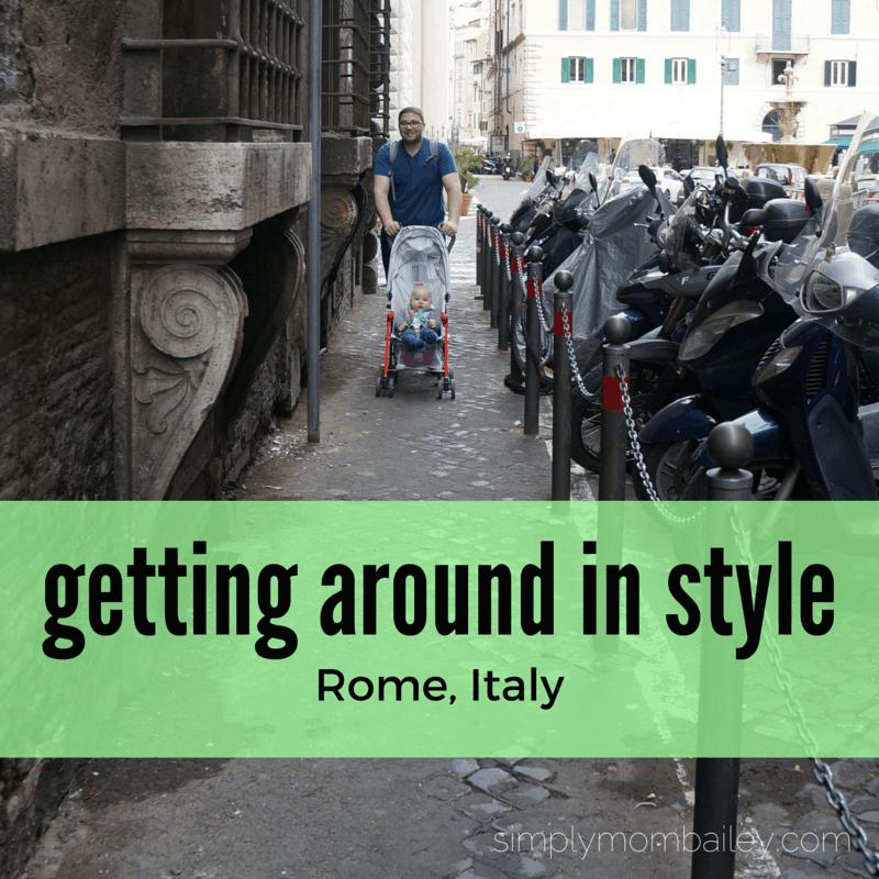 dad pushing maclaren stroller in rome, italy