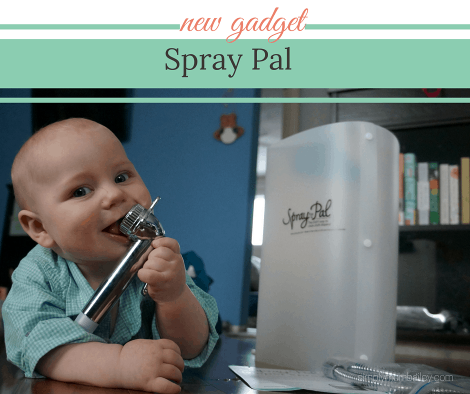 cute baby boy with spray pal cloth diaper sprayer