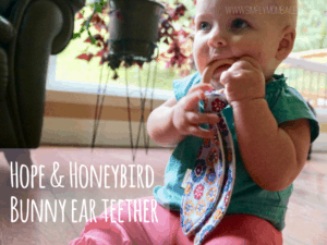 Cutting Canines is miserable for cranky babies. Check these tips on how to survive teething with babies and toddlers at www.simplymombailey.com. The Hope & Honeybird Bunny Ear Teether is the perfect locally made teething toy for babies to chew on. Locally made with natural products! #madeincanada #teethingbabies