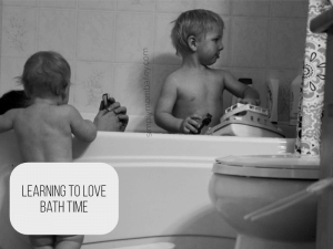 Two Kids Splashing in and around the bath tub.
