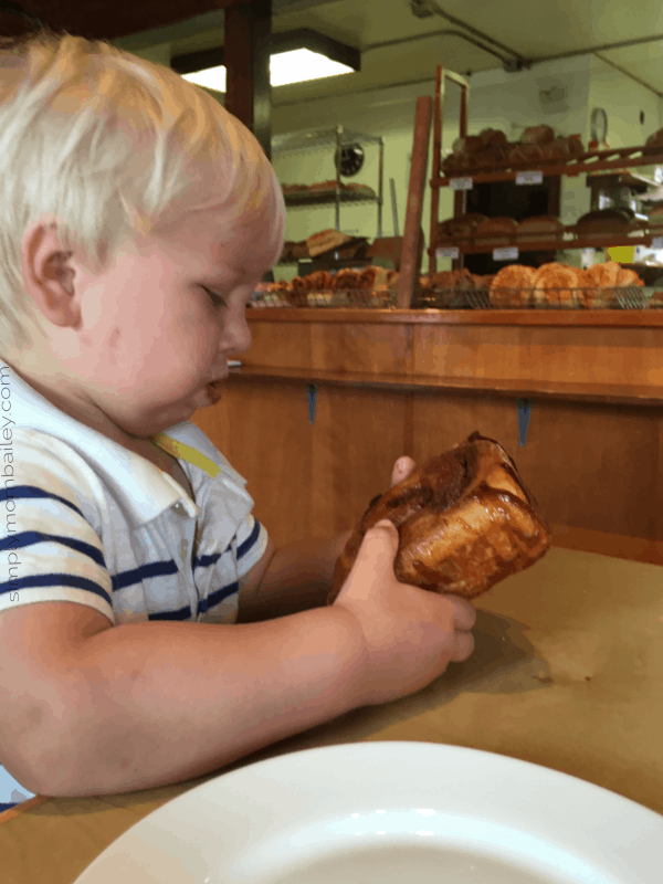 Cinnamon Bun eating toddler at the Skeena Bakery in Hazelton
