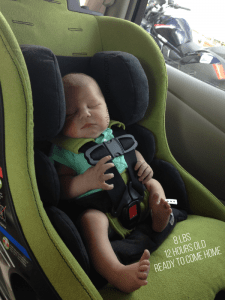 Infant Baby Boy in a Clek Convertible Car Seat coming home from the hospital