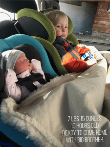 Infant Baby girl coming home from the hospital in a matching Clek Carseat to Big Brother