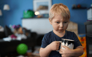 Toddler Holding Coffee Cup