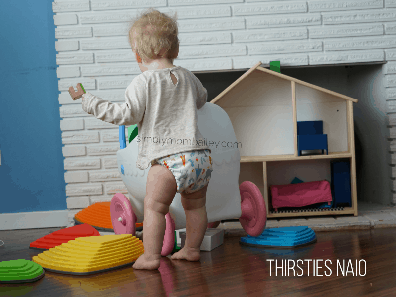 playing in thirsties natural all in one cloth diaper for babies