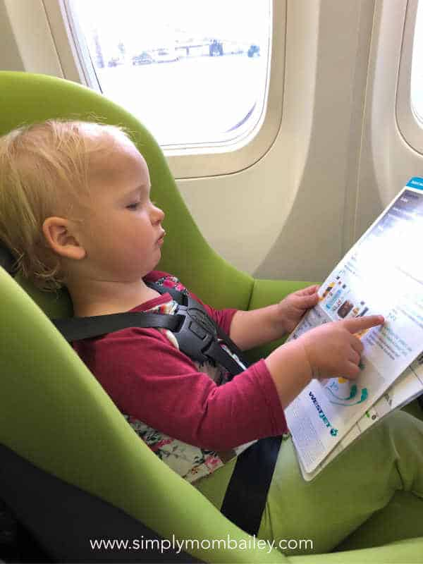 Reading the Safety Card in the Airplane