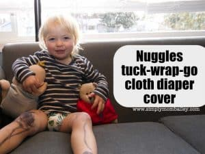 Nuggles Tuck-Wrap-Go Cover on a toddler